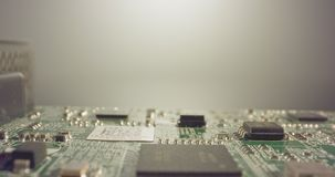 Extreme macro dolly shot of a PCB computer board with capacitors and transistors stock video footage