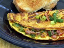 Extreme macro of a Western Omelet. An extreme macro of a Western or Denver omelet.  Omelet includes ham, cheese, peppers, and onions Royalty Free Stock Photography