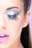 Extreme makeup. Beautiful half face Stock Photography