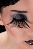 Extreme makeup with feather eyelashes Stock Images
