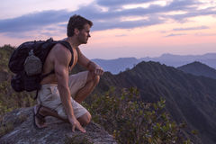 Extreme male adventure hiker on mountain top Stock Images