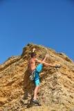 Extreme man climbing up Stock Image