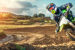Extreme Motocross MX Rider riding on dirt track. On a sunny late summer day on public training session in preparation for Motocross event Stock Photos