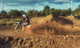Extreme Motocross MX Rider riding on dirt track Royalty Free Stock Image