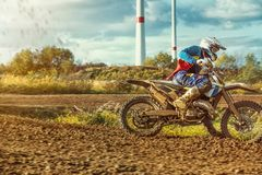 Extreme Motocross MX Rider riding on dirt track Stock Images