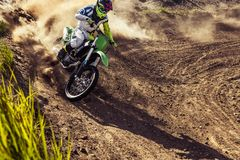 Professional dirt bike rider. Extreme Motocross MX Rider riding on dirt track royalty free stock image