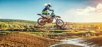 Extreme Motocross MX Rider riding on dirt track Stock Photo