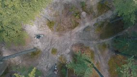 Extreme motorcyclists rides on the forest roads. Motocross. Motosport. Stock footage of motorcycle. Aerial view stock footage
