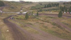 Extreme Motorsport of SUVs driving on country road. Clip. Top view of race track for SUVs in forest.  stock images