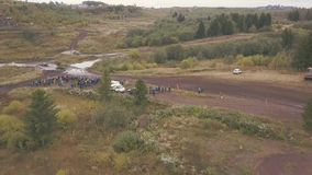 Extreme Motorsport of SUVs driving on country road. Clip. Top view of race track for SUVs in forest.  stock photography
