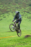 Extreme mountain bike downhill contest Stock Photos