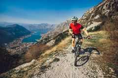 Mountain bike sport athlete man riding outdoors lifestyle trail. Extreme mountain bike sport athlete man riding outdoors lifestyle trail royalty free stock photo