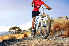 Adventure sport. Extreme mountain bike sport athlete man riding outdoors lifestyle trail Royalty Free Stock Photos