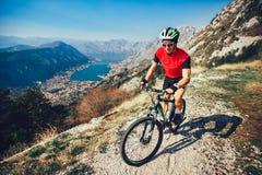 Extreme mountain bike sport man riding outdoors lifestyle trail. Extreme mountain bike sport athlete man riding outdoors lifestyle trail royalty free stock image
