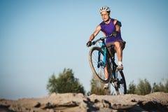 Extreme mountain bike sport man riding outdoors Stock Photo