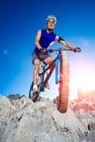 Extreme mountain bike sport man riding outdoors Stock Image