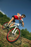 Extreme MTB cyclist. Mountain bike racer off road driving down hill Royalty Free Stock Image