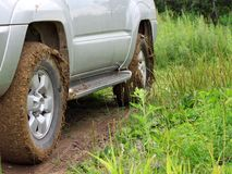 Extreme offroad behind  car in mud Stock Images