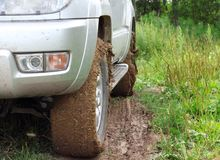 Extreme offroad behind  car in mud Royalty Free Stock Photos