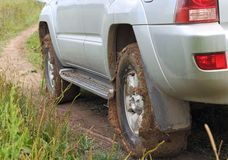 Extreme offroad behind car in mud Stock Photos
