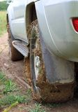 Extreme offroad behind car in mud Stock Photo