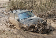 Extreme offroad car. In mud Royalty Free Stock Photo