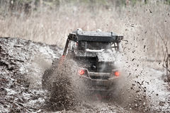 Extreme offroad car in mud Stock Photography