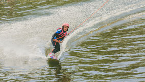 Extreme Park, Kiev, Ukraine, 07 may 2017 - a little girl to ride a Wakeboard. Photo of grain processing Stock Photo