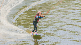 Extreme Park, Kiev, Ukraine, 07 may 2017 - a little girl to ride a Wakeboard. Photo of grain processing Stock Images