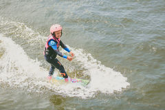 Extreme Park, Kiev, Ukraine, 07 may 2017 - a little girl to ride a Wakeboard. Photo of grain processing Royalty Free Stock Image