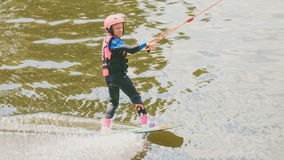 Extreme Park, Kiev, Ukraine, 07 may 2017 - a little girl to ride a Wakeboard. Photo of grain processing Royalty Free Stock Photos