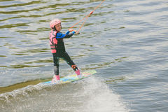 Extreme Park, Kiev, Ukraine, 07 may 2017 - a little girl to ride a Wakeboard. Photo of grain processing Stock Photos