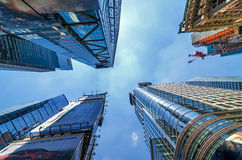 Extreme Perspective of Skyscrapers in Times Square. Extreme perspective of modern skyscrapers in the Times Square area of Midtown Manhattan Royalty Free Stock Images