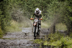 Extreme racer on a motorcycle rides puddle Stock Photos