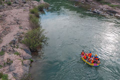 Extreme rafting on the rapid river on an inflatable yellow kayak Stock Photo