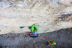 Girl climber on a rock Royalty Free Stock Photography