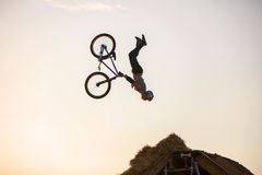 Extreme rider falling while making a bike jump. Stock Photo