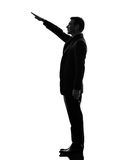 Extreme right wing  man saluting silhouette. One caucasian extreme right wing man saluting  in silhouette  on white background Royalty Free Stock Images