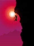 Extreme rock climber. Silhouette of an extreme rock climber climbing a mountain Stock Photos