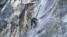 Extreme rock climber climbs difficult route in the mountains Royalty Free Stock Photography