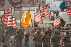 Extreme Rodeo Opening Ceremony. Members of the National Guard hold American and New Mexico State Flags during the national anthem opening ceremony of The Heat royalty free stock image