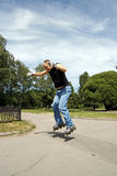 Extreme rollerblader. Jumping in park stock photography