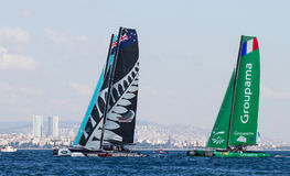 Extreme Sailing Series. ISTANBUL, TURKEY - SEPTEMBER 13, 2014: Groupama and Emirates Team New Zealand competes in Extreme Sailing Series royalty free stock images