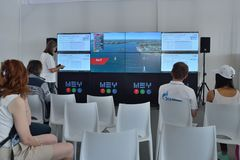 Extreme Sailing Series in St. Petersburg, Russia. St. Petersburg, Russia - August 22, 2015: People watching the race using the SAP software during the St royalty free stock photography