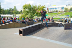 Extreme skateboarding tricks. PETROZAVODSK, RUSSIA - JULY 13: Extreme sports festival on July 13, 2011, Petrozavodsk, Russia. Skateboarding tricks by pro riders Stock Photography