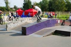 Extreme skateboarding tricks. PETROZAVODSK, RUSSIA - JULY 13: Extreme sports festival on July 13, 2011, Petrozavodsk, Russia. Skateboarding tricks by pro riders Stock Photos