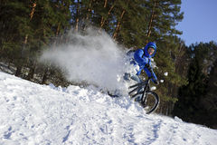 Extreme snow cycling Stock Photo