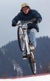 Extreme snow mountain biking Stock Photos