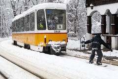 Extreme Snowboard ride behind a tram in Sofia Royalty Free Stock Photos