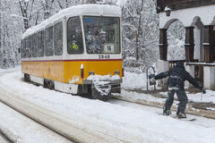 Extreme Snowboard ride behind a tram in Sofia Stock Photo